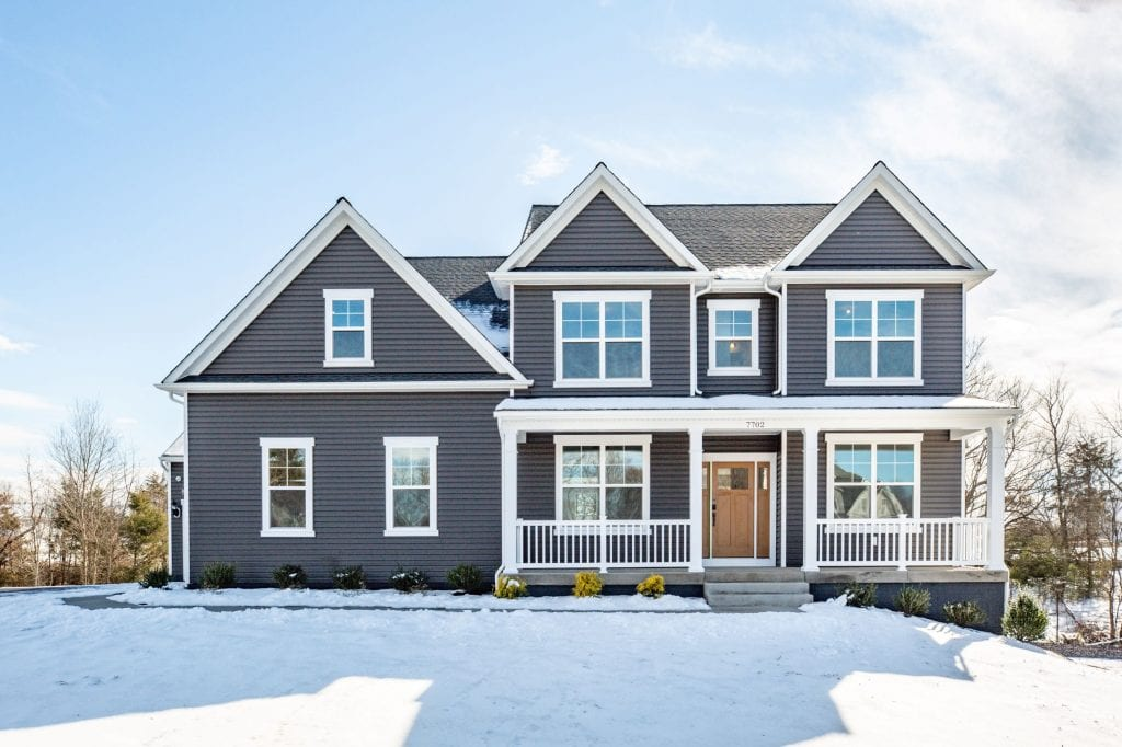 front of a home with grey siding